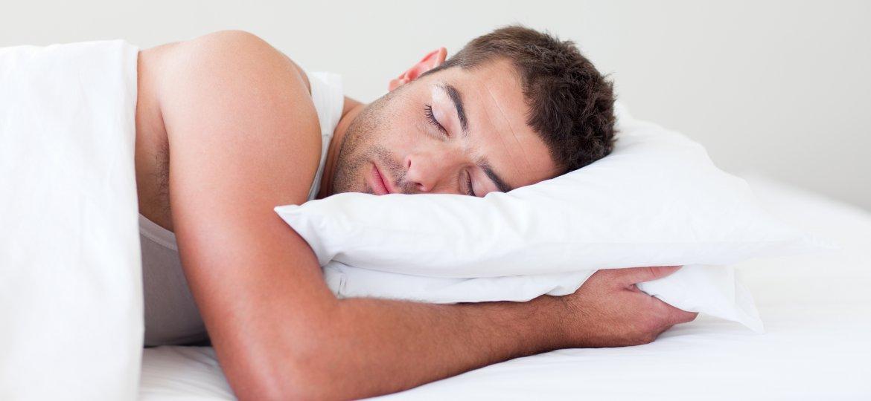 Man-Sleeping-In-Bed-5126308